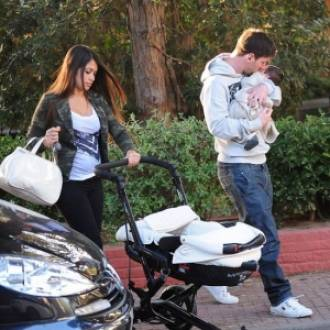 Lionel Messi and Antonella Roccuzzo with their son