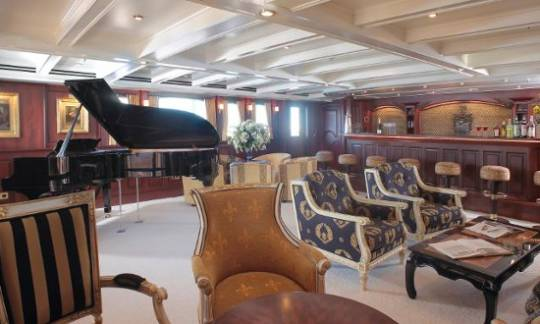 SS Delphine yacht music room with the grand piano