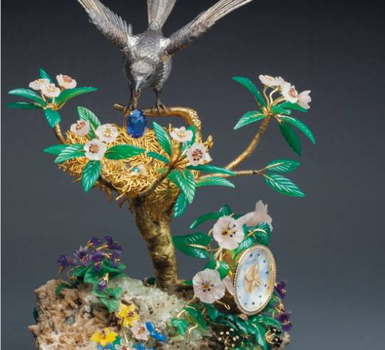 The Magpie's Nest Clock with jewels like rubies, diamonds, and amethyst