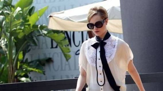 Evan Rachel Wood was spotted wearing the stylishly designed white colored crepe blouse with lace detailing from D & G while attending the 68th Year Venice Film Festival.