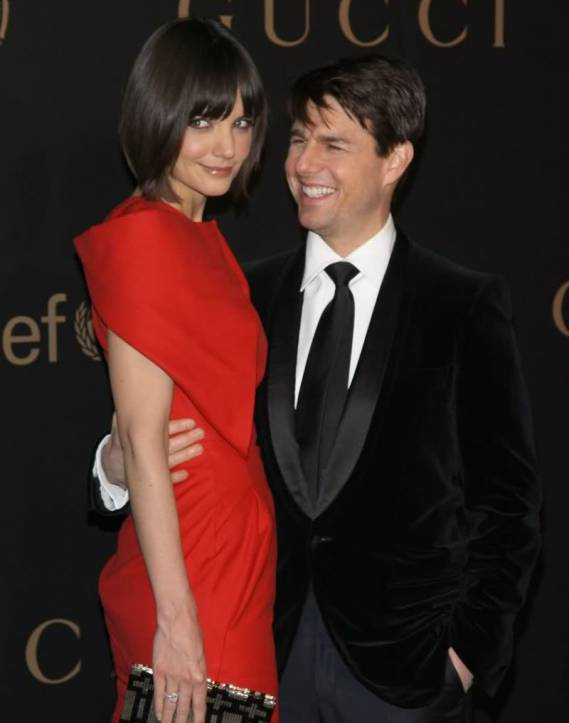 Katie Holmes and Tom Cruise attend a reception to benefit Madonna's charity, Raising Malawi
