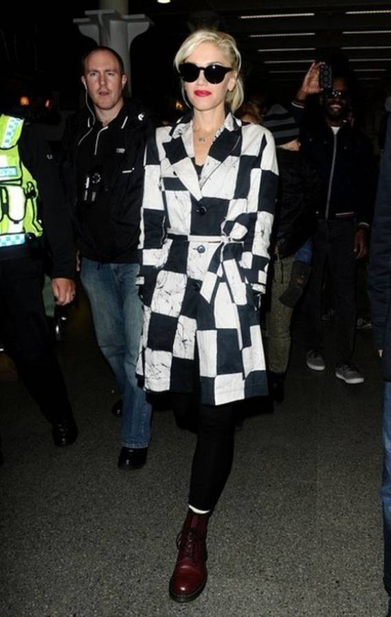 Gwen wears Kelly Wearstler Noir Batik-Twill Trenchcoat