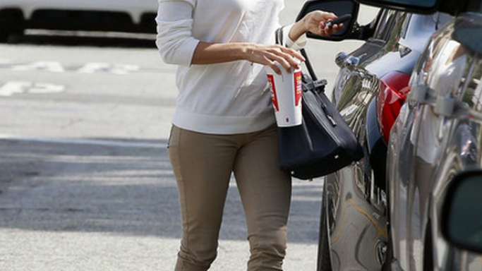 Eva Longoria has been spotted wearing Lacoste Chalk V-Neck Pullover several times