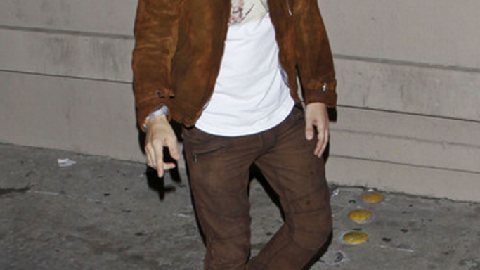 David was spotted wearing a pair of Christian Louboutin Alfie flat sneakers in brown pony print.