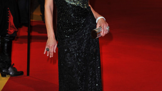 The actress has been photographed wearing this black designer gown at several fashion events.
