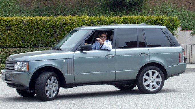 John was photographed driving out of Hollywood star Kate Perry's Los Angeles residence in his '$50,000' metallic black Range Rover SUV.