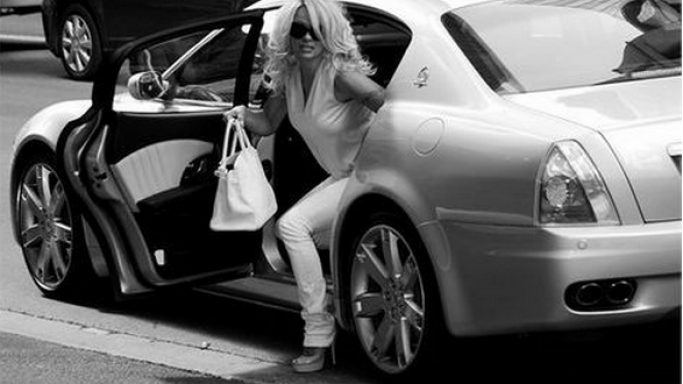 Quattroporte car - Color: White  // Description: luxurious powerful