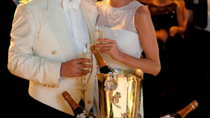 Prince Albert II enjoying the Champagne with Princess Charlene.