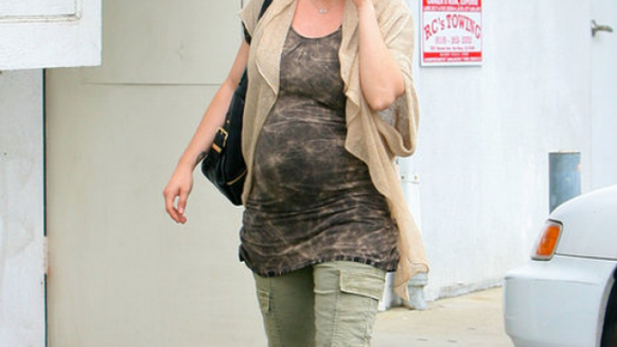 Wearing a loose top to cover her mommy-tummy, Alyssa Milano wore Cargos from J Brand.