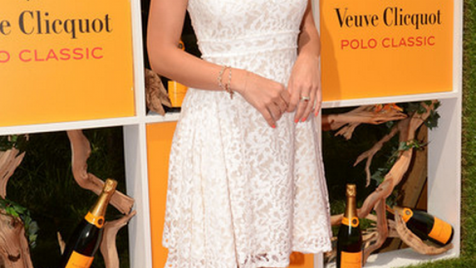 "Minka Kelly showed up the Fifth Annual Veuve Clicquot Polo Classic event wearing a pair of stunning ""Summerissima"" platform sandals from Christian Louboutin's Spring 2012 collection."