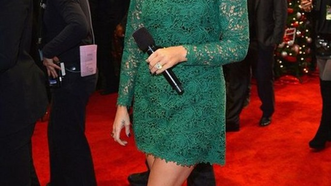 The reality star walked the red carpet of the X Factor finale wearing the glamorous Valentino green lace dress.