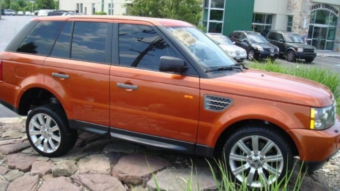 Range Rover car - Color: Orange  // Description: exclusive